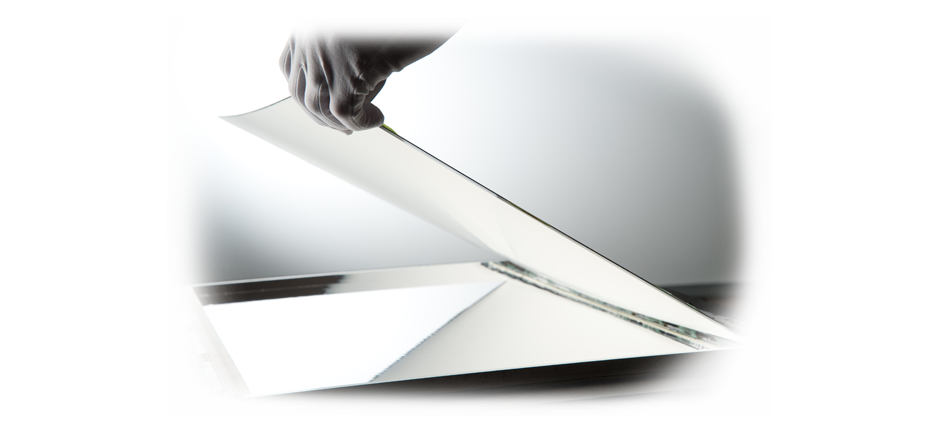 Gloved hand separating 3M reflector films | American Polarizers, Inc.