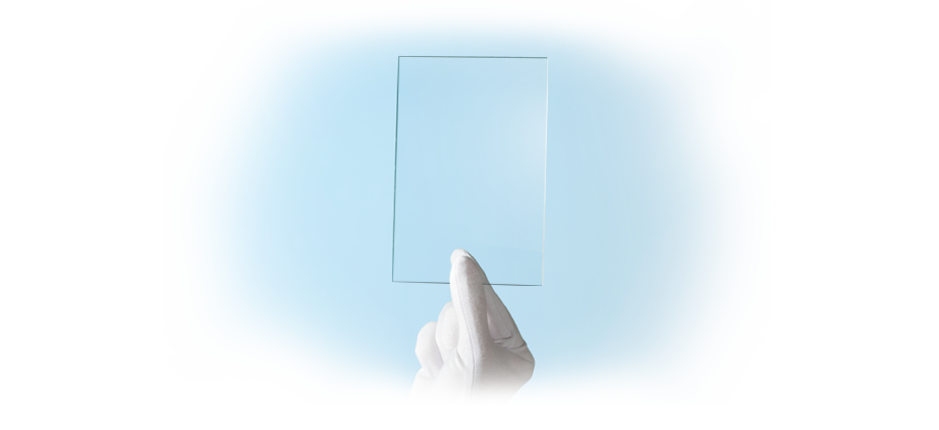 White gloved hand holding an example Quarter Wave & Half Wave Retarder Film | American Polarizers, Inc.