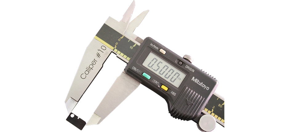 Digital Calipers Measuring a small item | American Polarizers, Inc.